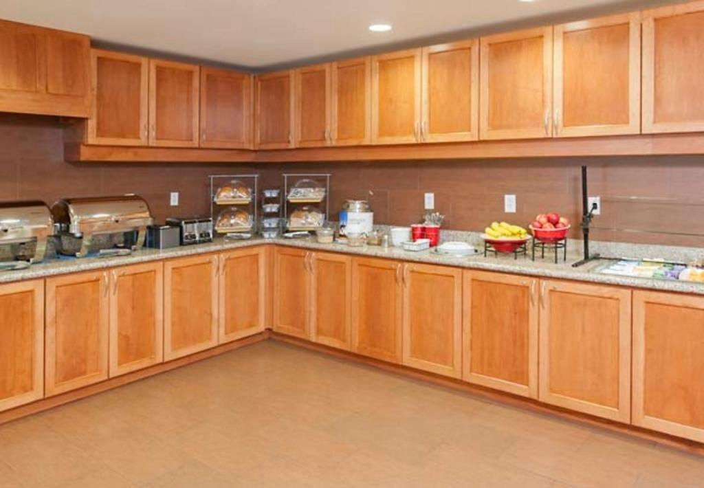 A kitchen or kitchenette at Residence Inn Moline Quad Cities