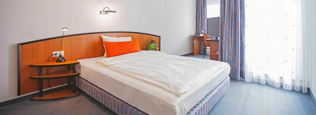 Ein Bett oder Betten in einem Zimmer der Unterkunft Hotel Restaurant Maître