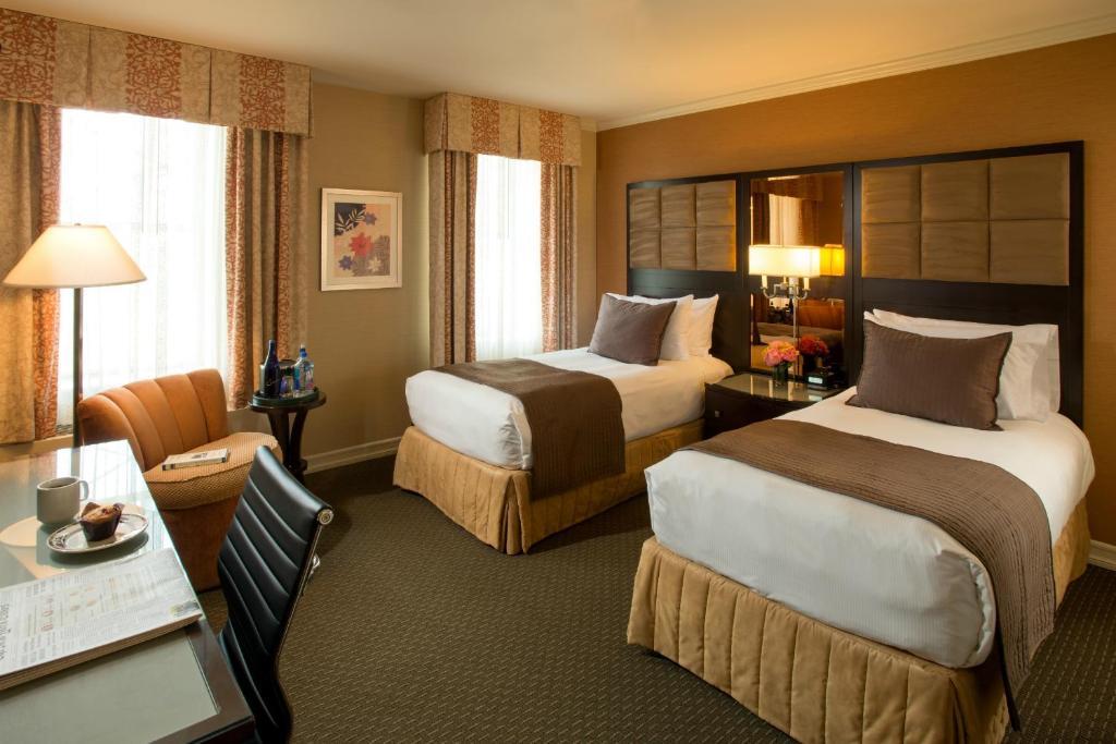 Cama o camas de una habitación en Excelsior Hotel