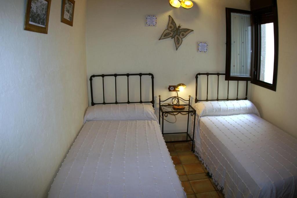 Cama o camas de una habitación en La Casa de la Abuela