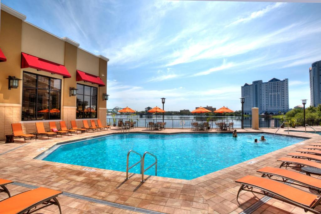 The swimming pool at or near Ramada Plaza by Wyndham Orlando Resort Near Universal