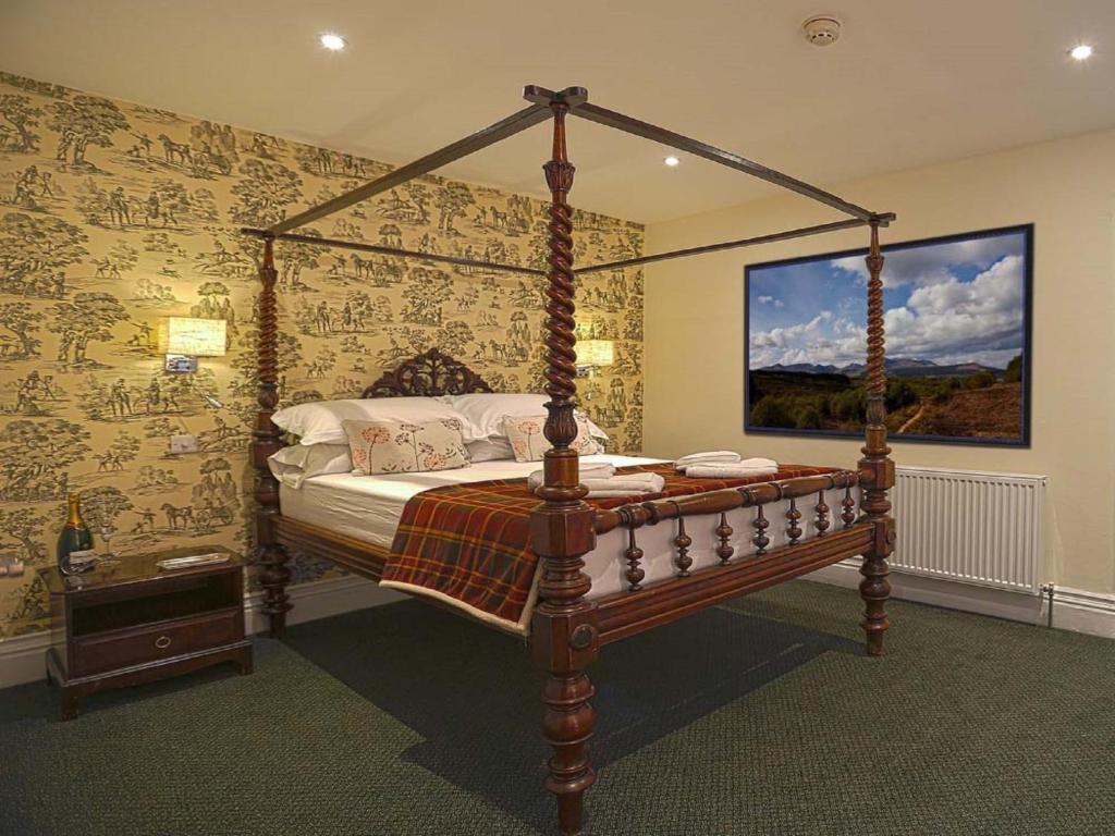 Llit o llits en una habitació de The Royal Station Hotel
