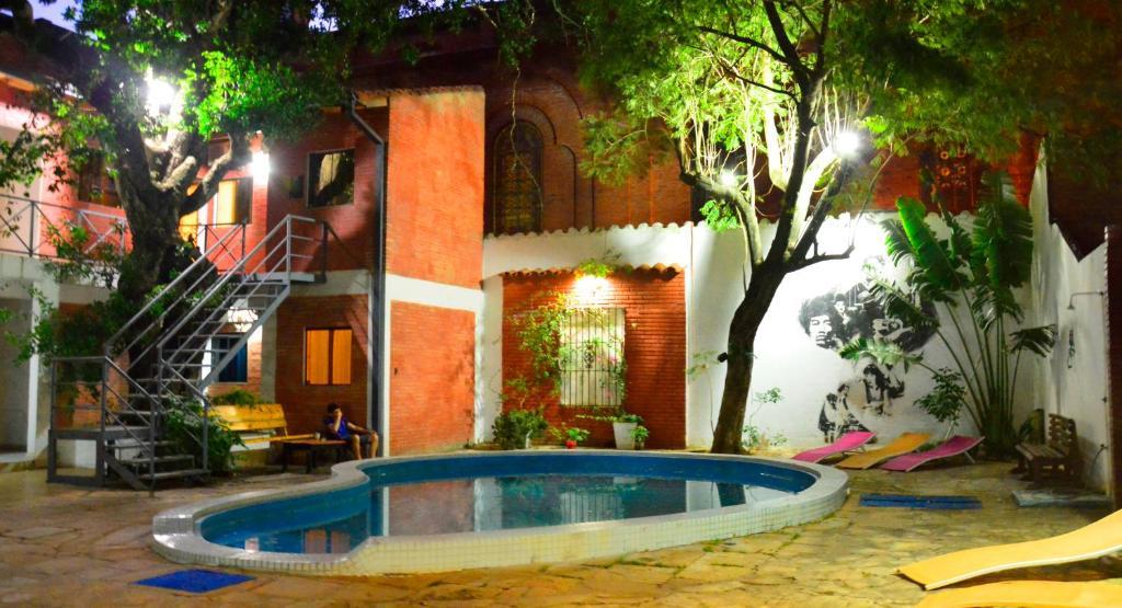 The swimming pool at or near El Viajero Asuncion Hostel & Suites