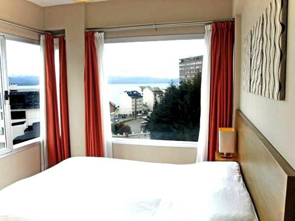 Una cama o camas en una habitación de BarilocheCentro I