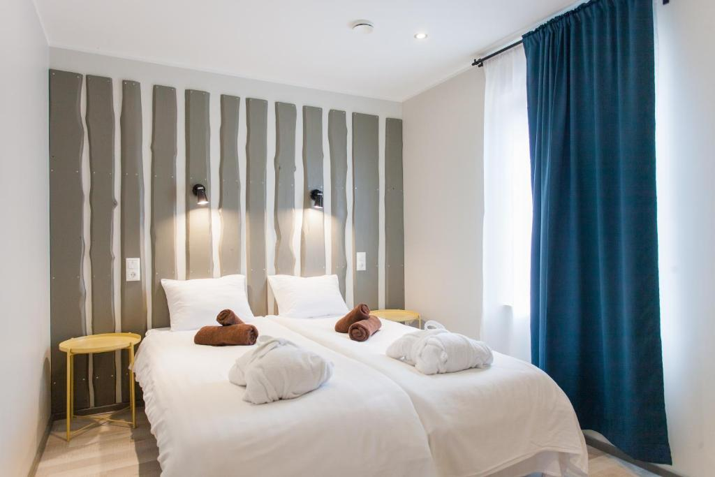 A bed or beds in a room at Johan Suites & Spa