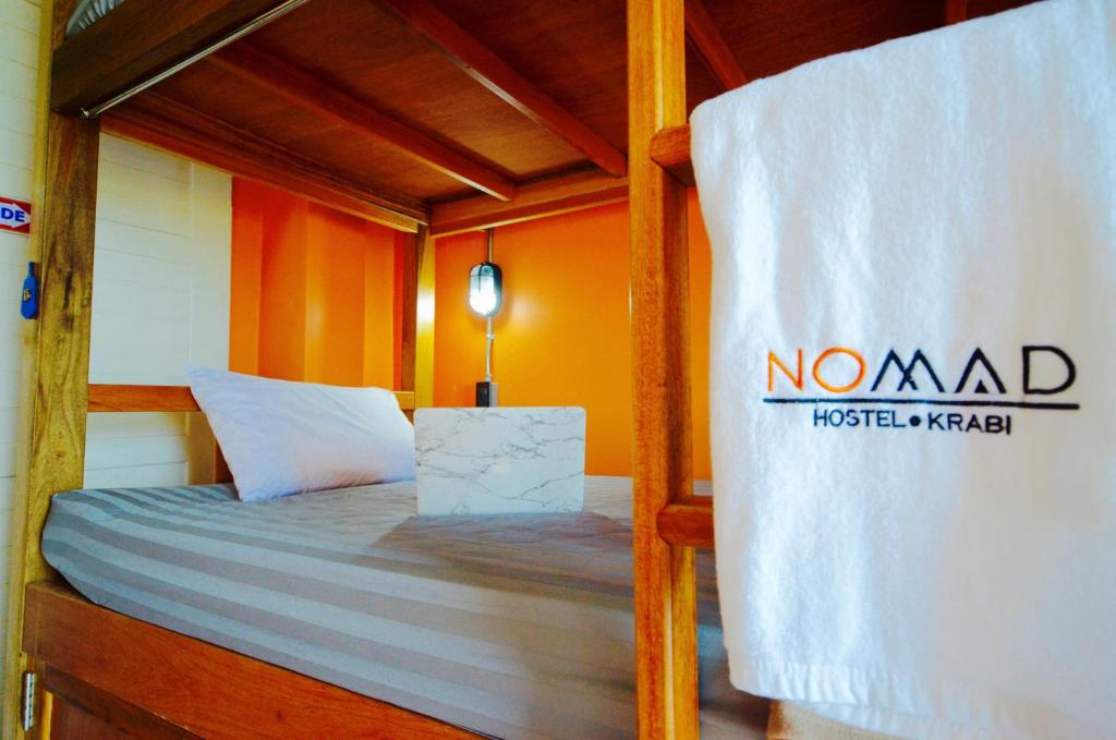 A bed or beds in a room at NOMAD Hostel Krabi