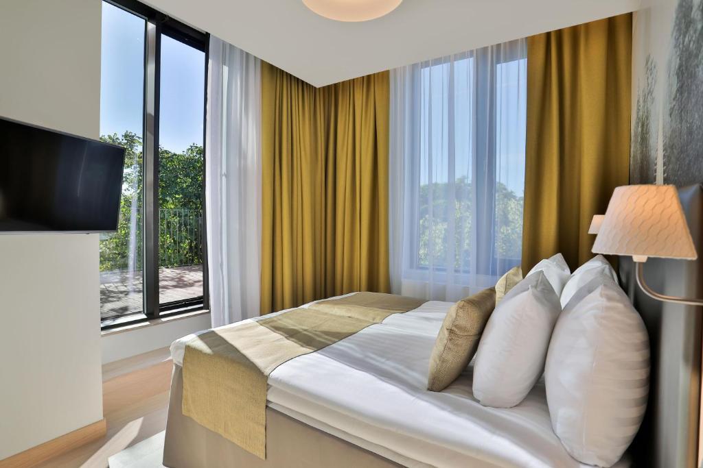 Voodi või voodid majutusasutuse Centennial Hotel Tallinn toas