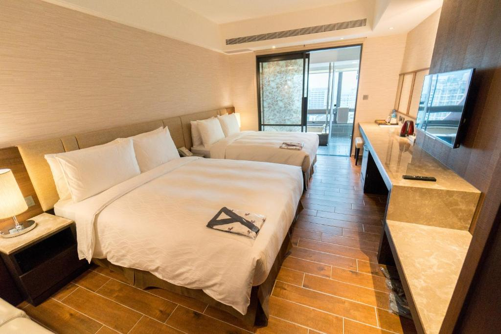 A bed or beds in a room at Kilin Jiaoxi