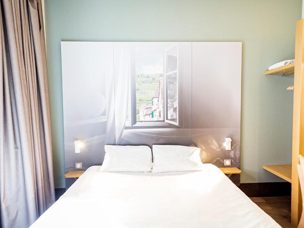 Cama o camas de una habitación en B&B Hôtel Mulhouse Centre
