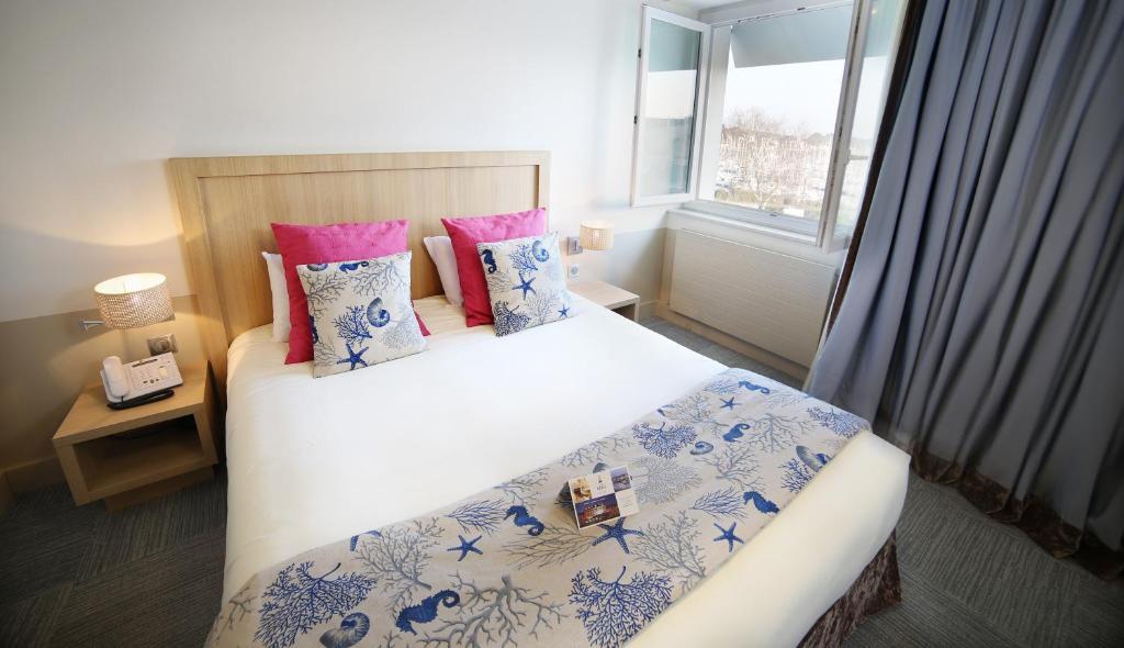 Ein Bett oder Betten in einem Zimmer der Unterkunft Trinite Hotel