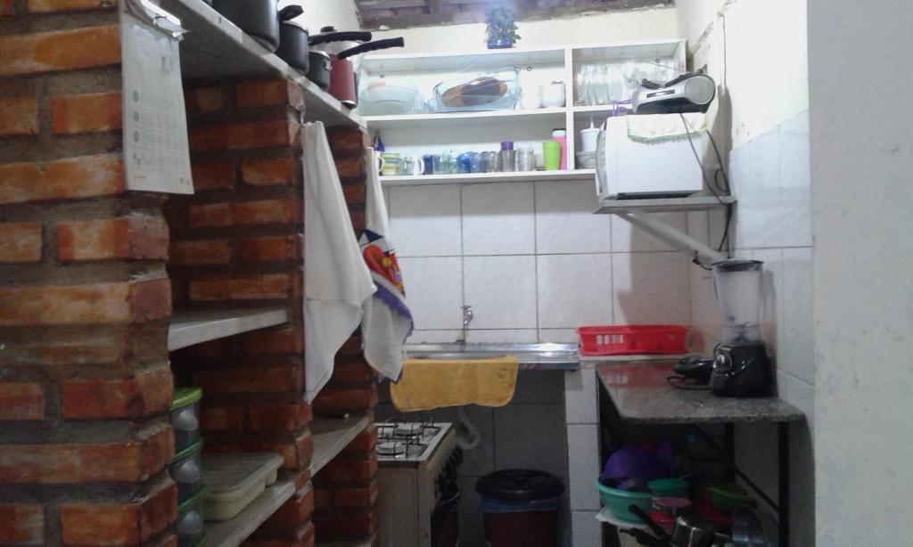 A kitchen or kitchenette at Casa dos Srs. Flávio e Maria José