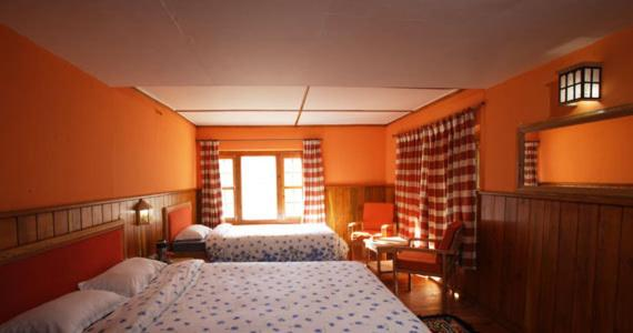 A bed or beds in a room at Yeti Mountain Home, Namche