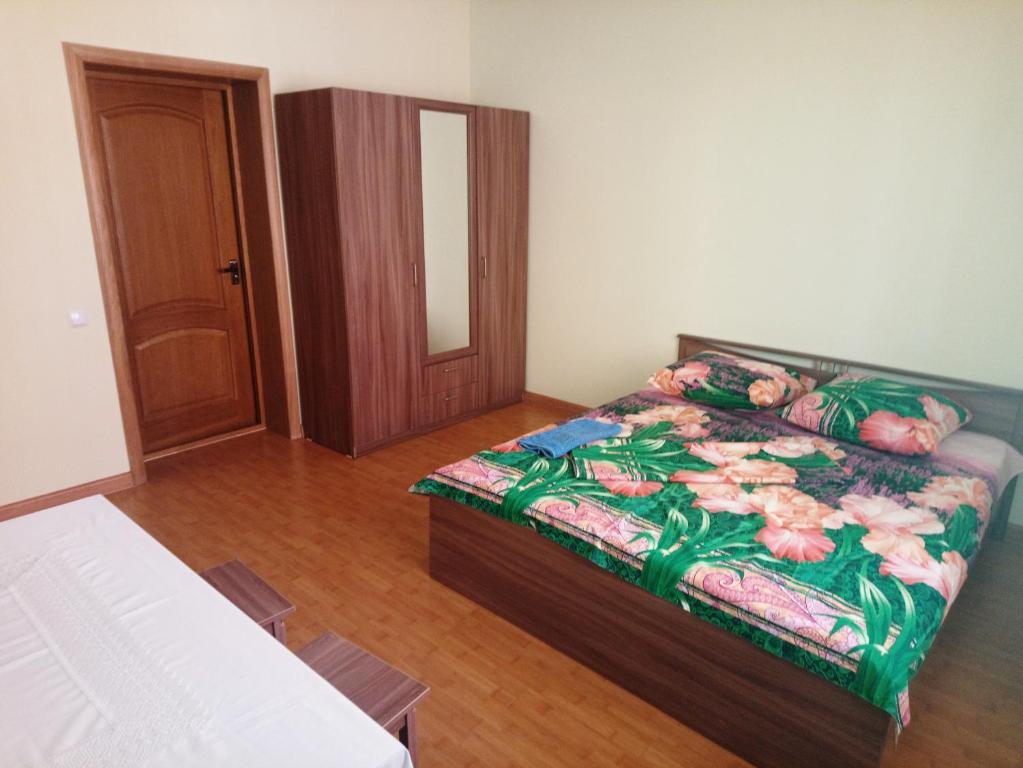Кровать или кровати в номере Guesthouse V Ghostyah