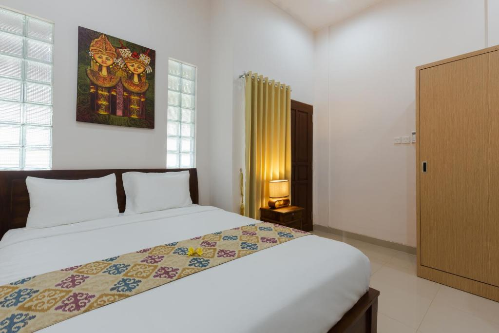 A bed or beds in a room at Kubal Bed and Living