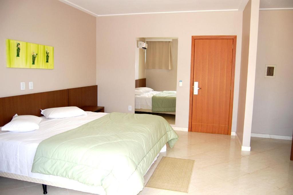 A bed or beds in a room at Hotel e Restaurante Bordignon
