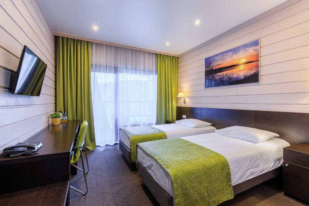 Кровать или кровати в номере Точка на Карте Сортавала