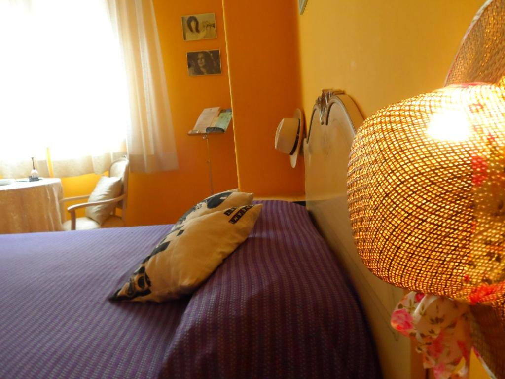 Cama ou camas em um quarto em B&B Radioretro