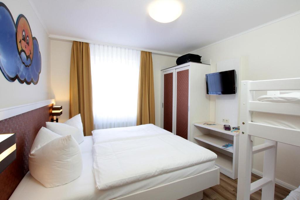 Postel nebo postele na pokoji v ubytování Park Hotel Sellin