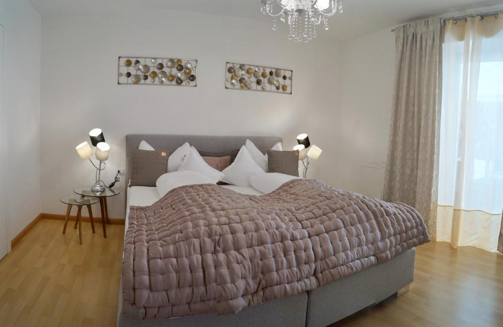 A bed or beds in a room at Apartment Meran