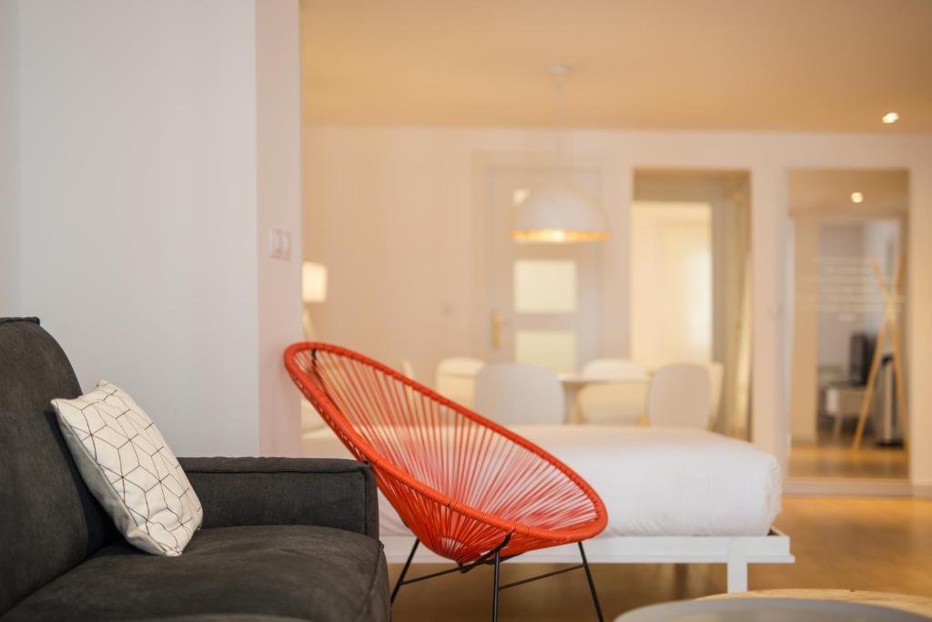 A seating area at Apartamento SoMbrereria RiMboMbin