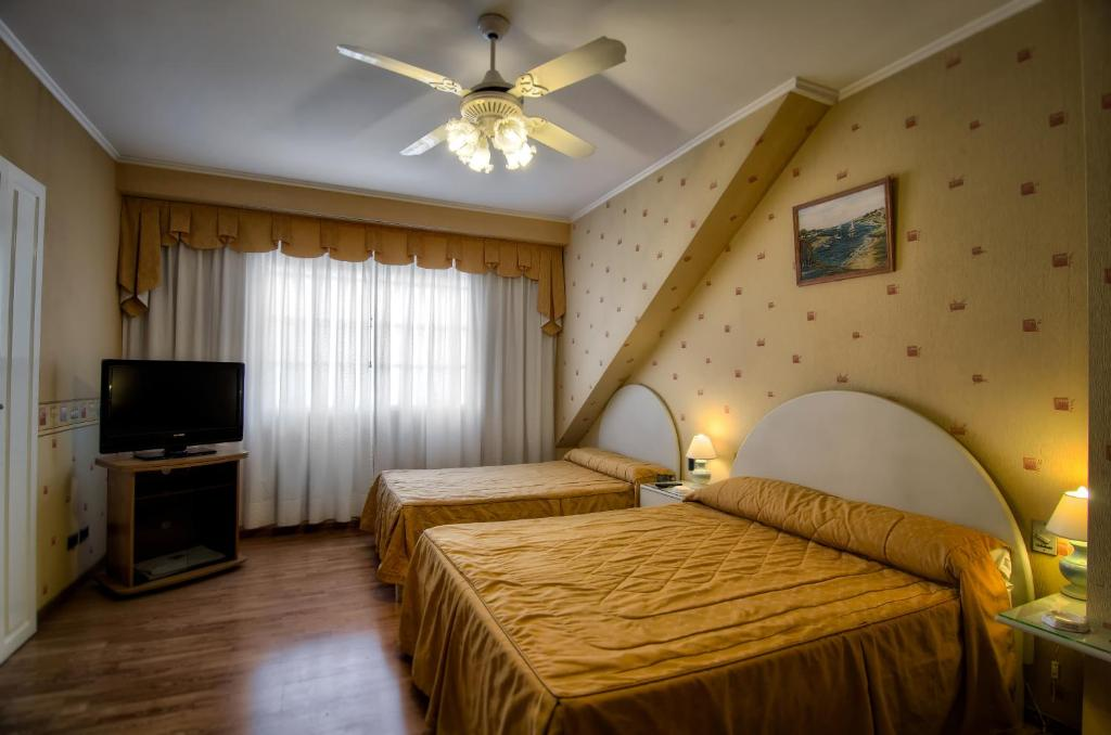 מיטה או מיטות בחדר ב-Hotel Internacional
