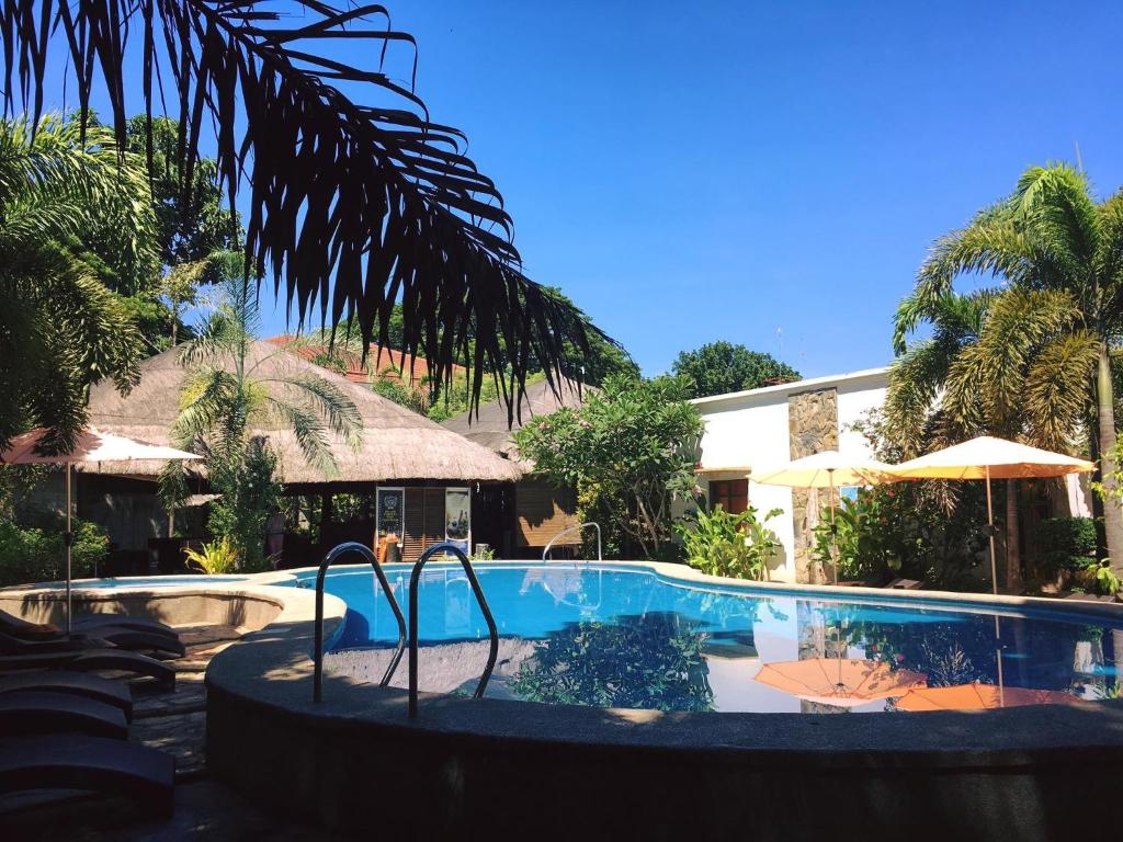 The swimming pool at or near Acacia Tree Garden Hotel