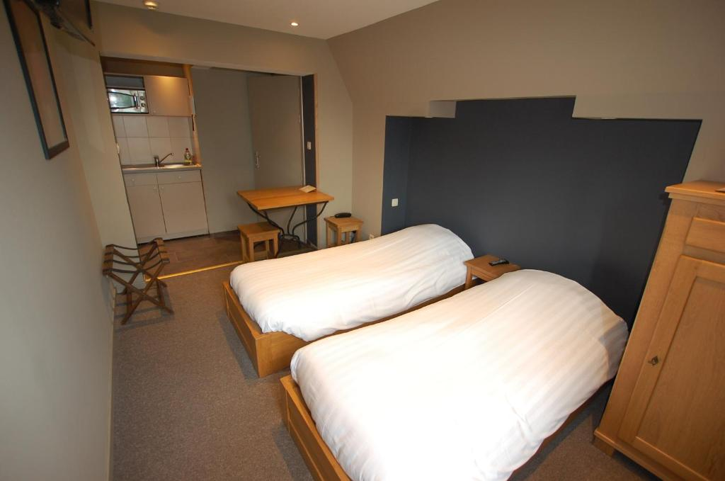Кровать или кровати в номере Hotel Piano 2