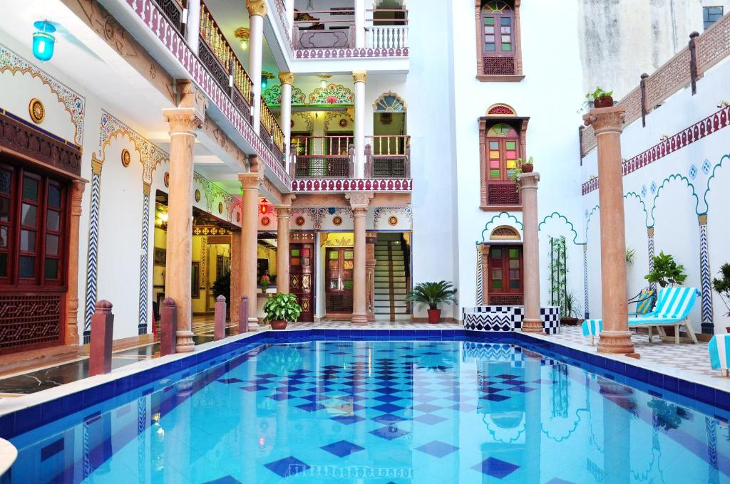 The swimming pool at or near Hotel Vimal Heritage