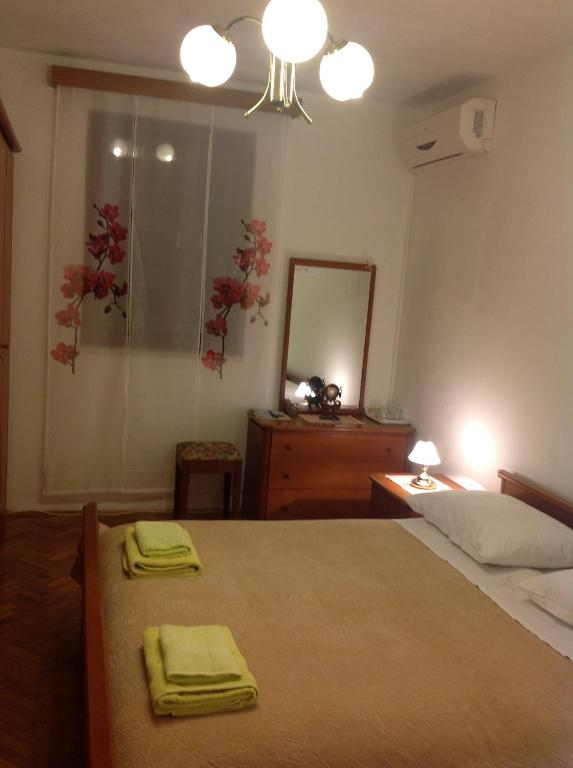 A bed or beds in a room at Guest House Loredana