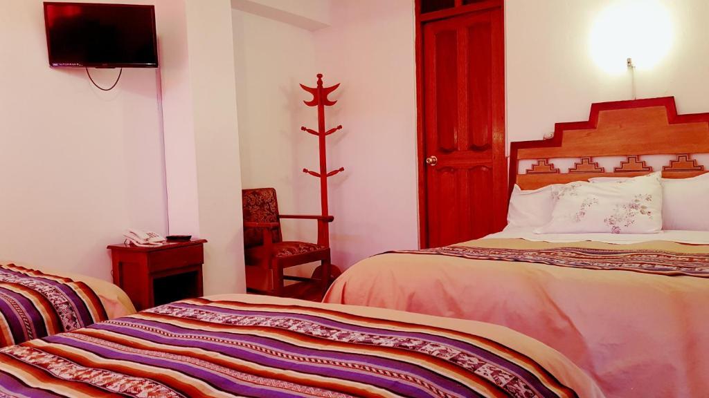 Cama o camas de una habitación en Pumamarca Guest House