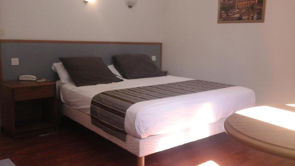 Un ou plusieurs lits dans un hébergement de l'établissement Hotel Boreal