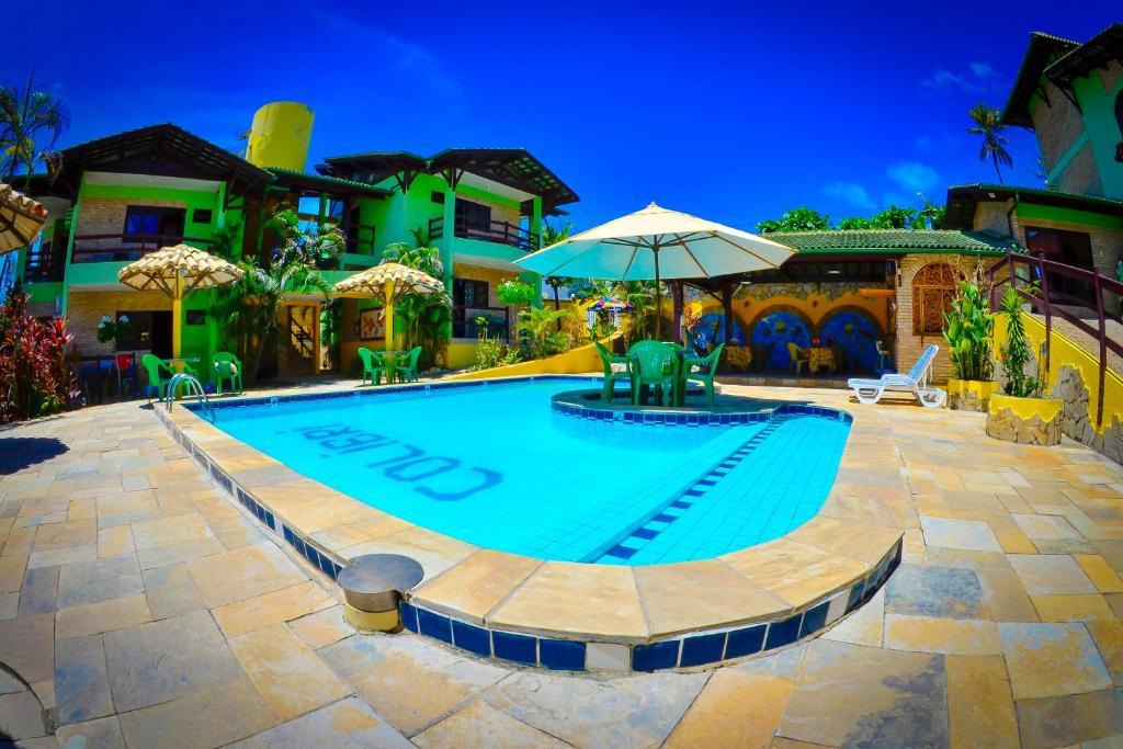 A piscina localizada em Hotel Pousada Porto do Colibri ou nos arredores