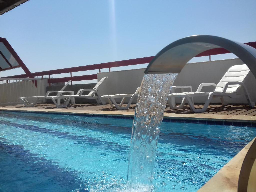 The swimming pool at or near Hotel Flat Bassano Vaccarini