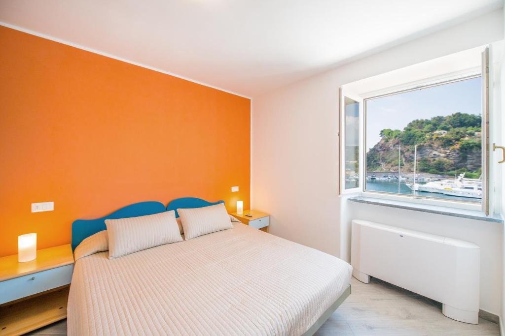 Кровать или кровати в номере Hotel Ristorante Crescenzo