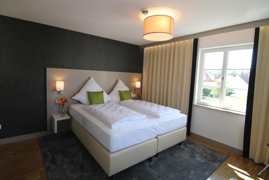 Ein Bett oder Betten in einem Zimmer der Unterkunft BA Hotel