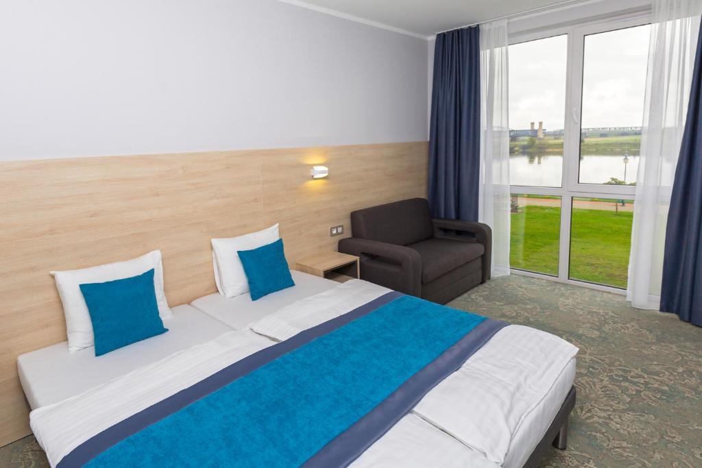 Lova arba lovos apgyvendinimo įstaigoje Hotel Vela