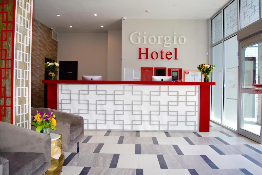 The lobby or reception area at Giorgio Hotel