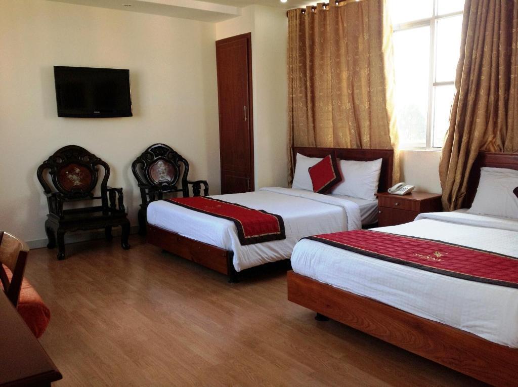 En eller flere senge i et værelse på Ava Saigon 3 Hotel