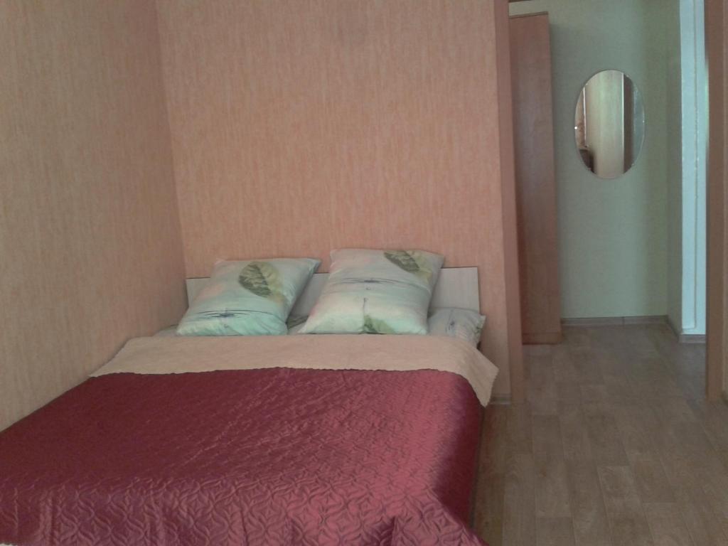 Кровать или кровати в номере Apartment Klimasenko 3/4