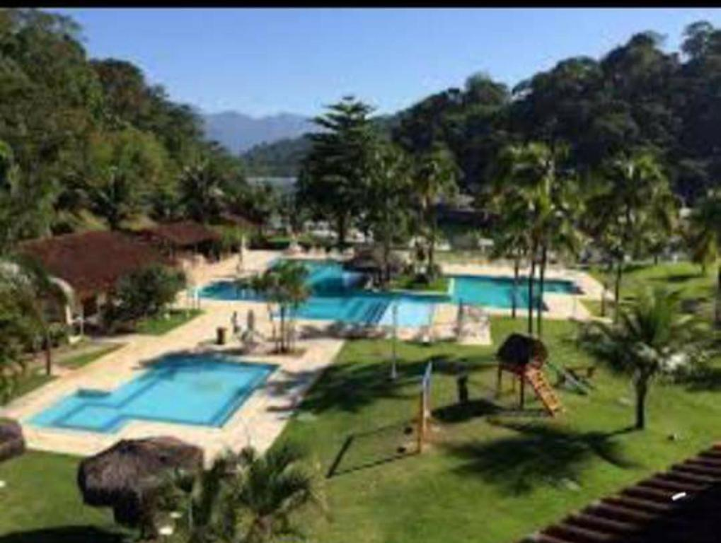 A view of the pool at Condominio Angra Green Coast or nearby
