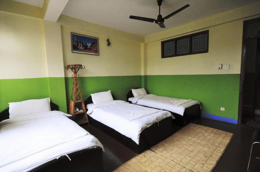 A bed or beds in a room at Metro Eco Hotel