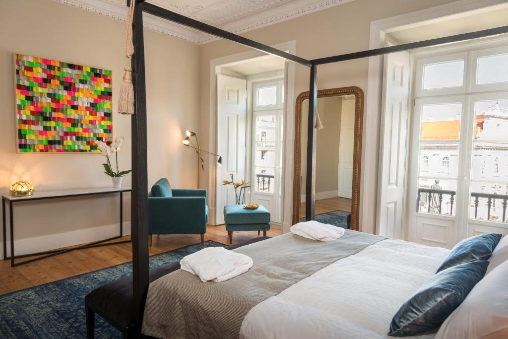 A bed or beds in a room at Le Consulat