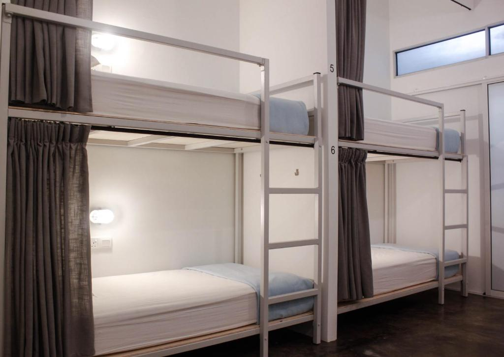 A bunk bed or bunk beds in a room at The Bridge Loft Dormitory