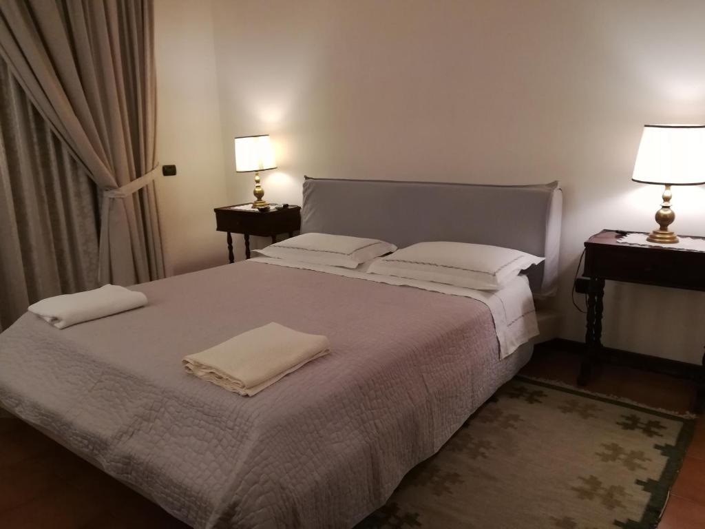 Letto o letti in una camera di B&B Villetta San Giorgio