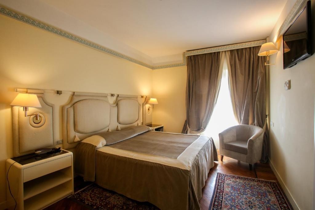 Кровать или кровати в номере Grand Hotel Tettuccio