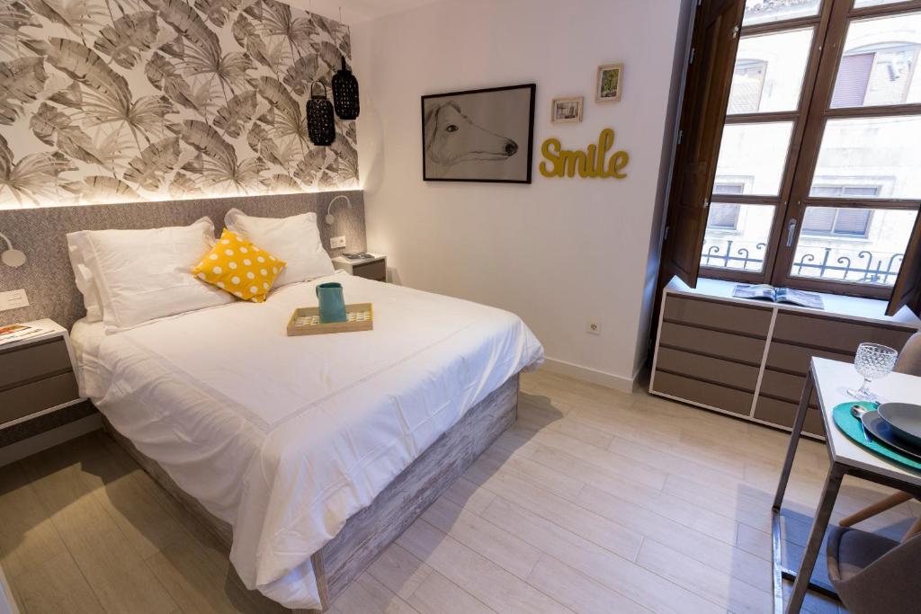 Cama o camas de una habitación en BeSalamanca