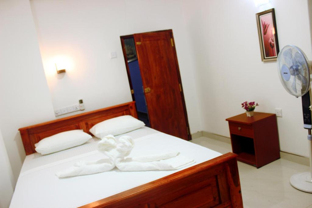 A bed or beds in a room at Hotel Camorich