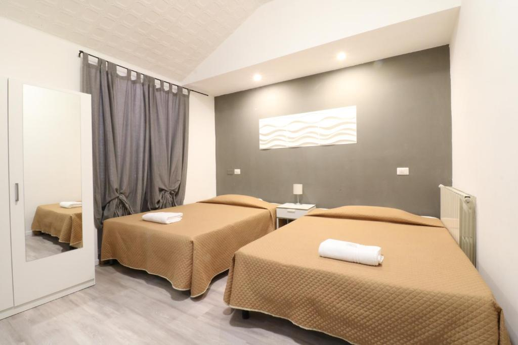 A bed or beds in a room at Guest House Minas