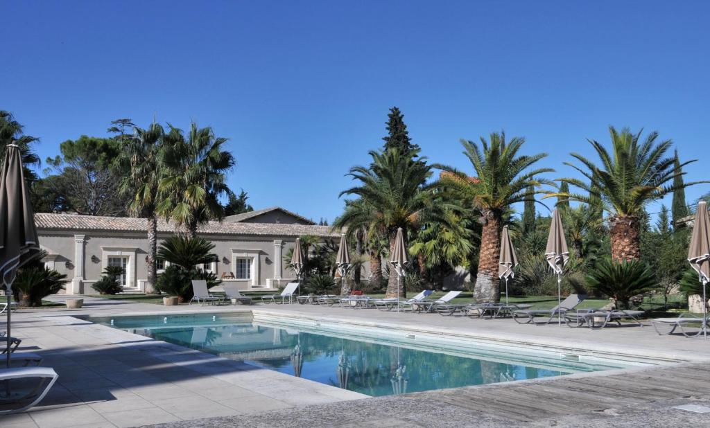 The swimming pool at or near Domaine du Grand Malherbes