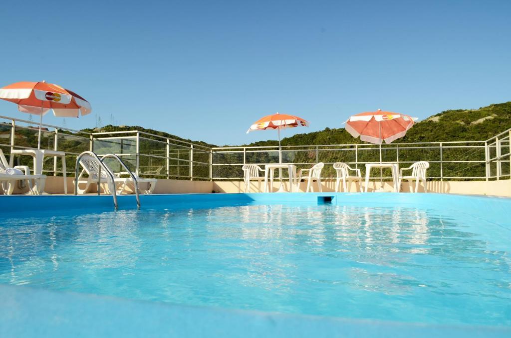 The swimming pool at or near Joaquina Beach Hotel